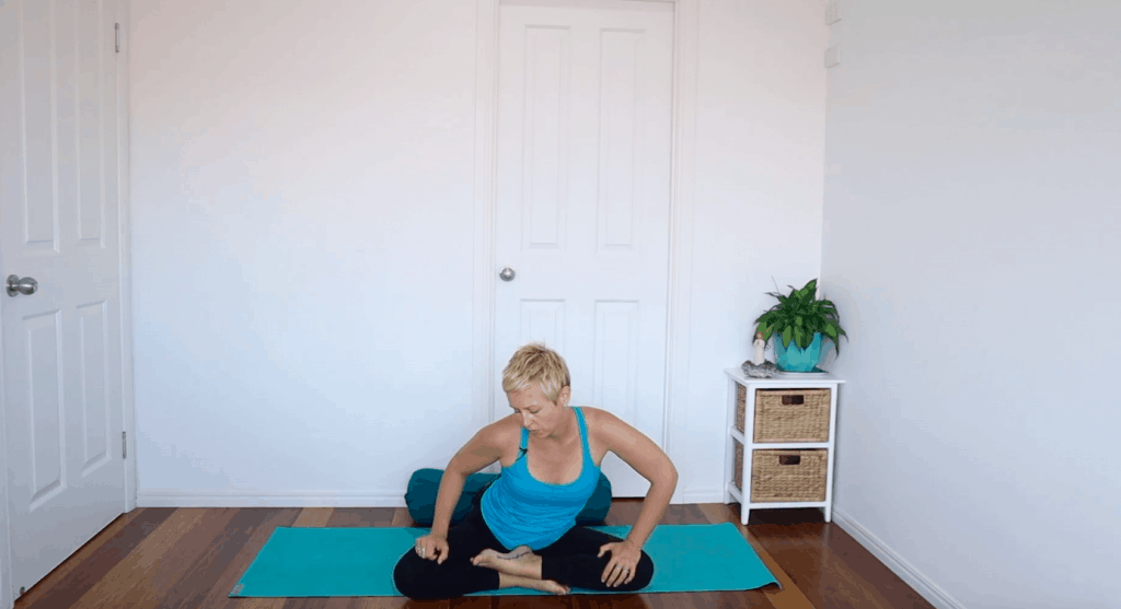 Fertility yoga pose: Seated hip circles to increase mobility and circulation in the pelvis / reproductive organs for fertility