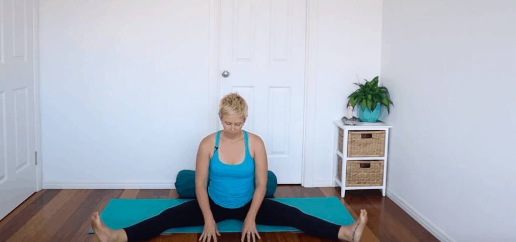 Fertility yoga pose:  Seated wide-Leg Forward Fold to open pelvis and groin, and increase circulation to sexual organs for improved fertility.