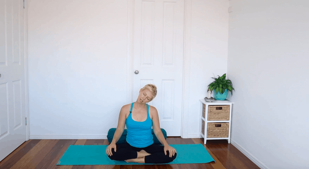 Fertility yoga pose: Seated Neck Stretch to release stress and tension stored in the neck and shoulders for fertility