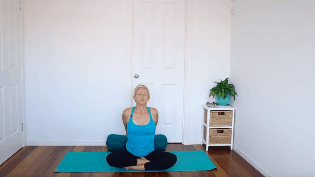 Fertility yoga pose:  Seated Chest Stretch to help reduce anxiety and improve energy in the body for fertility