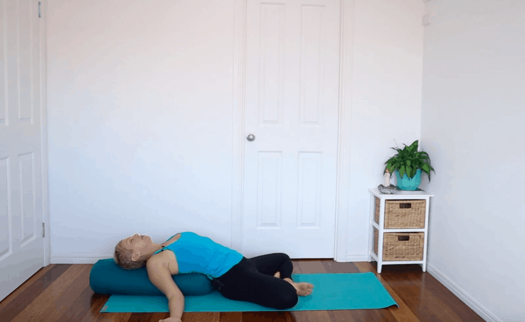 Fertility yoga pose: Reclined Butterfly to help reduce stress and anxiety and improve circulation to sexual organs when trying to conceive